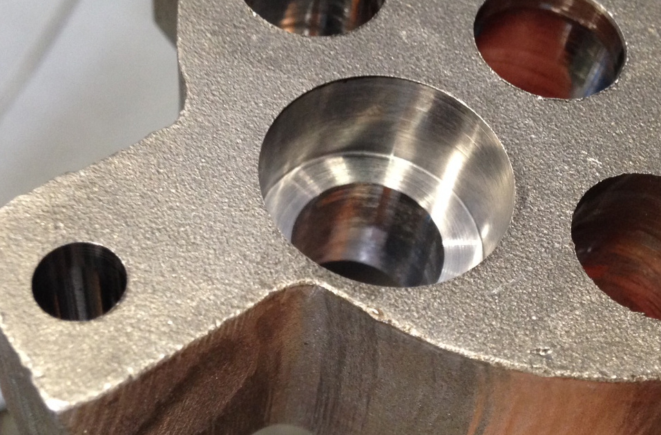 countersinks on a gear component for a tractor