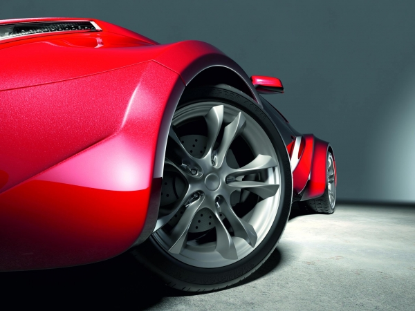 Picture of a red sports car with alloy wheels