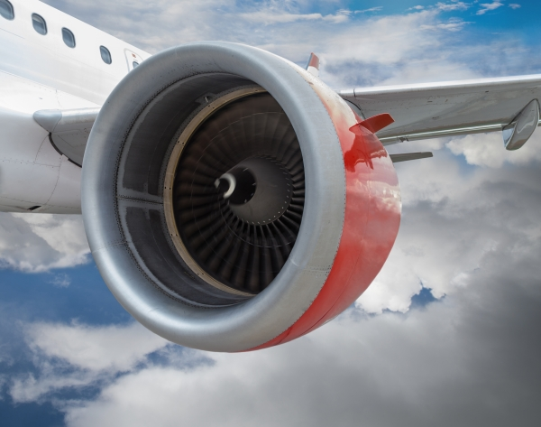 Picture of an airplane engine against a blue sky
