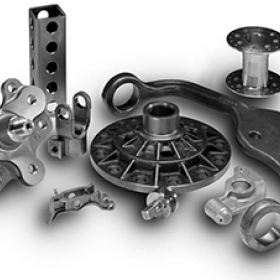 Picture of various parts machined on a CNC machine with a deburring and chamfering tool